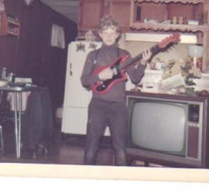 Rusty w Red Guitar when young
